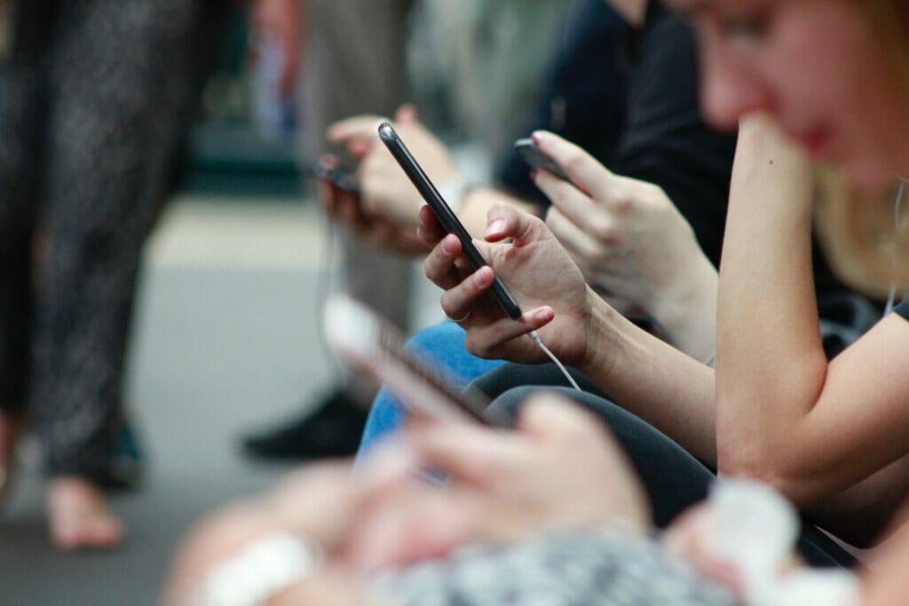 hands using smartphones
