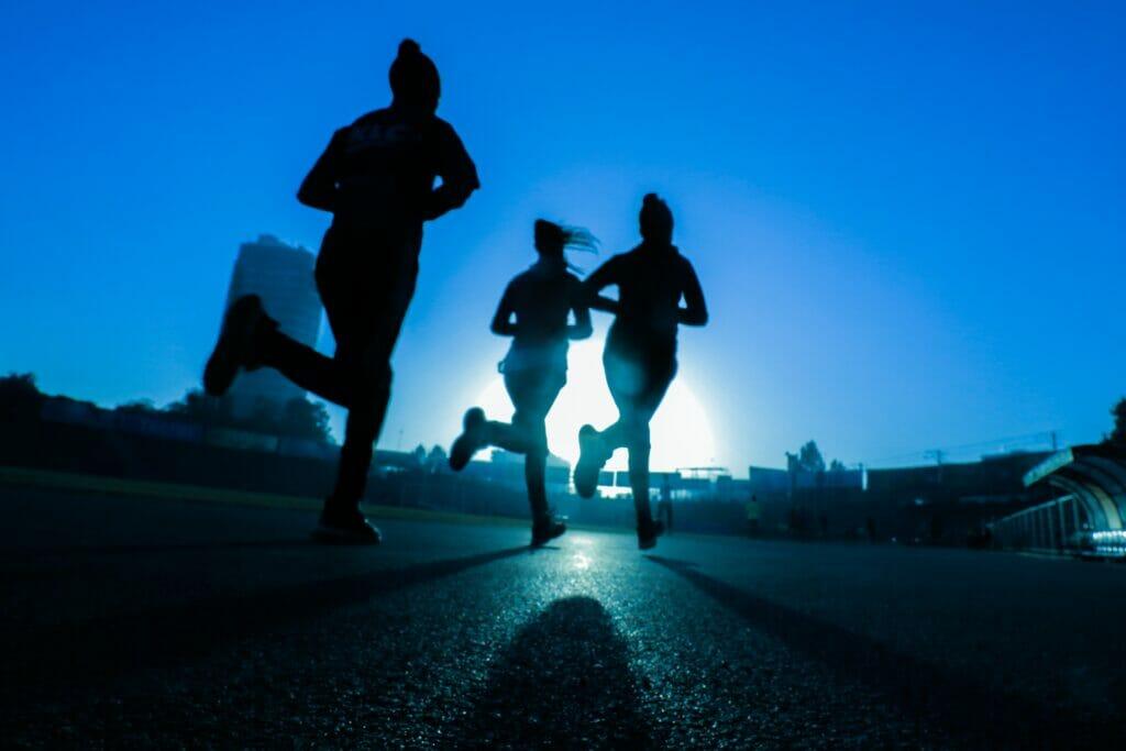 women running in the dark